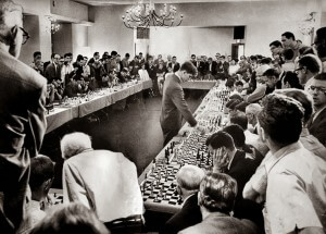 Bobby Fischer, playing 50 opponents simultaneously at his Hollywood hotel on 12 April 1964